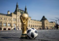 Trophy of the FIFA World Cup. April 16, 2018 Moscow. Russia Trophy of the FIFA World Cup and official ball of FIFA World Cup 2018 Adidas Telstar 18 on the Red Stock Photos
