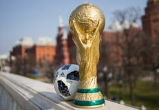 Trophy of the FIFA World Cup. April 16, 2018 Moscow. Russia Trophy of the FIFA World Cup and official ball of FIFA World Cup 2018 Adidas Telstar 18 on the Red Royalty Free Stock Photo