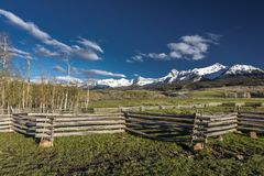 APRIL 27, 2017 - near Ridgway and Telluride Colorado - a Rail Fence and San Juan Mountains,.  Ridgway,  No People. APRIL 27, 2017 - near Ridgway and Telluride Stock Photo