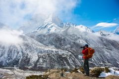 12 April 2018 - Nepal ::Traveller take a picture with snow mount Stock Photography
