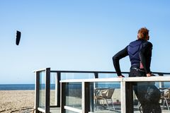 Man equipment surfer stand wind rest blue sun sky sea north. April, 9, 2018. North Sea in The Hague, Scheveningen district, the Netherlands. Man stand on Stock Image