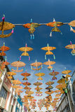 "April 19, 2016 - Petaling Jaya, Malaysia : The beautiful and colorful ""Wau"" or kites hanged the middle of the buildings. Of Petaling Jaya street of Selangor Royalty Free Stock Images"