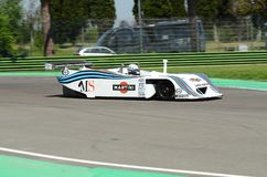 21 April 2018: Riccardo Patrese drive Lancia Martini LC1 prototype during Motor Legend Festival 2018. At Imola Circuit in Italy royalty free stock image