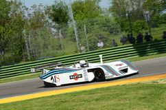21 April 2018: Riccardo Patrese drive Lancia Martini LC1 prototype during Motor Legend Festival 2018 at Imola Circuit. In Italy royalty free stock photography