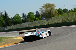 21 April 2018: Riccardo Patrese drive Lancia Martini LC1 prototype during Motor Legend Festival 2018 at Imola Circuit. In Italy stock photography