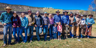 APRIL 22, 2017, RIDGWAY COLORADO: Cowboys and Cowgirls pose against fence at Centennial Ranch, Ridgway, Colorado- a cattle ranch o Royalty Free Stock Photography