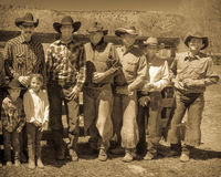 APRIL 22, 2017, RIDGWAY COLORADO: Cowboys and Cowgirls pose against fence at Centennial Ranch, Ridgway, Colorado- a cattle ranch o Royalty Free Stock Images