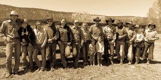 APRIL 22, 2017, RIDGWAY COLORADO: Cowboys and Cowgirls pose against fence at Centennial Ranch, Ridgway, Colorado- a cattle ranch o Royalty Free Stock Photo