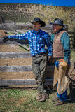 APRIL 22, 2017, RIDGWAY COLORADO: Father Vince Kotny & son during cattle branding exchange words, at Centennial Ranch, Ridgway, Co Royalty Free Stock Image