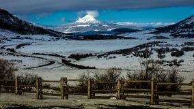 APRIL 27, 2017 RIDGWAY COLORADO -Hastings Mesa shows Volcanic Mountain and rail fence in the San. Day, Volcano. APRIL 27, 2017 RIDGWAY COLORADO -Hastings Mesa royalty free stock images