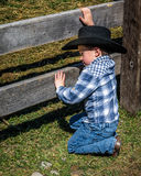 APRIL 22, 2017, RIDGWAY COLORADO: Young cowboy during cattle branding on Centennial Ranch, Ridgway, Colorado - a ranch with Angus/ Royalty Free Stock Images