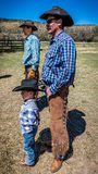 APRIL 22, 2017, RIDGWAY COLORADO: Young cowboy and father brand cattle on Centennial Ranch, Ridgway, Colorado - a ranch with Angus Royalty Free Stock Photo