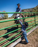 APRIL 22, 2017, RIDGWAY COLORADO: Young cowboy watches father brand cattle on Centennial Ranch, Ridgway, Colorado - a ranch with A Stock Photography