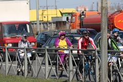 April 21, 2019, Russia, St. Petersburg, cyclists ride along the road stock images