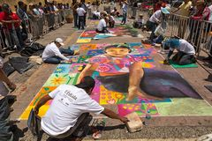 Street artists in San Cristobal de las Casas Mexico. April13, 2014 San Cristobal de las Casas, Mexico: street artists executing sidewalk chalk drawings depicting stock photo