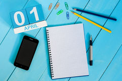 April 1st. Image of april 1 wooden color calendar on blue background. Empty space for text. All Fool`s Day.  royalty free stock photos