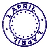 Grunge Textured 1 APRIL Round Stamp Seal. 1 APRIL stamp seal imprint with grunge texture. Designed with circles and stars. Blue vector rubber print of 1 APRIL vector illustration
