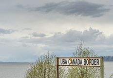 April 14, 2019 - Surrey, British Columbia: BNRR Railway USA Canada border sign. April 14, 2019 - Surrey, British Columbia: BNRR Railway USA Canada border sign royalty free stock image