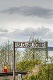April 14, 2019 - Surrey, British Columbia: BNRR Railway USA Canada border sign. April 14, 2019 - Surrey, British Columbia: BNRR Railway USA Canada border sign stock photography