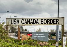 April 14, 2019 - Surrey, British Columbia: BNRR Railway USA Canada border sign. April 14, 2019 - Surrey, British Columbia: BNRR Railway USA Canada border sign royalty free stock photography