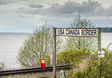 April 14, 2019 - Surrey, British Columbia: BNRR Railway USA Canada border sign. April 14, 2019 - Surrey, British Columbia: BNRR Railway USA Canada border sign stock image