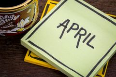 April text on a note with coffee Royalty Free Stock Images