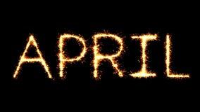 April Text Sparkler Glitter Sparks Firework Loop Animation. April Text Sparkler Writing With Glitter Sparks Particles Firework on Black 4K Loop Background stock video