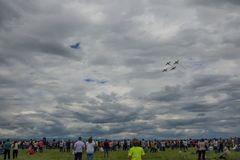 April 17th 2017 Ploiesti Romania, 4 planes formation flying over crowd with storm clouds in the background. April 17th 2017, Air show in Ploiesti Romania with 4 Royalty Free Stock Photo