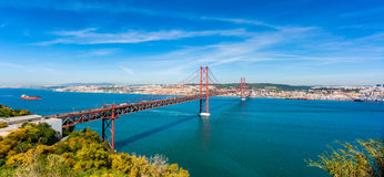 April 25th Bridge and Tagus River in Lisbon Portugal. Panoramic view on the April 25th Bridge crossing the Tagus river in Lisbon, capital of Portugal royalty free stock photography