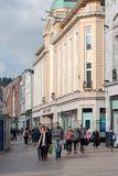 People shopping on Patrick Street in Cork, the city`s main street for stores, street performers, restaurants, and busy city life. April 13th, 2018, Cork Royalty Free Stock Photo