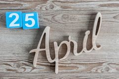 April 25th. Day 25 of month, daily calendar on wooden table background. Spring time theme.  Stock Photography