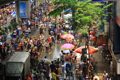 13 April, 2014: Tourists visit Thailand for Sonkran Festival at Silom road. Sonkran Festival is also called Thai New Year. Tourists come and play water splash on stock photography