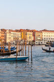 April 2017, Venice, Italy. Gondoliers and gondolas on the Grand Canal, at sunset Royalty Free Stock Image