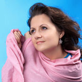 The April wind. Woman takes cover a scarf from a wind Royalty Free Stock Images