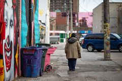 April 17 2019 Windsor Ontario Canada Street Photography Man Someone Anyone Somebody Anybody Walking Away Urban Alley. April 17 2019 Windsor Ontario Canada Street stock images