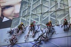 Migrant workers who demolished advertisements