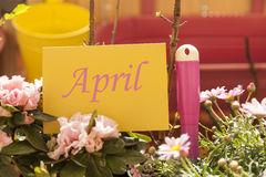 April written on card on balcony Stock Image