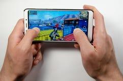Aprile 2019 Kramatorsk, Ucraina Giochi mobili di American National Standard di applicazione immagine stock