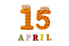 15 aprile su un fondo bianco dei numeri e delle lettere Immagine Stock