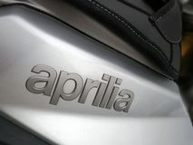 Apriliaembleem stock afbeelding