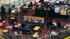 APRL 12, 2019 MOSCOW, RUSSIA: Coffee shop in the mall, people relaxing drinking coffee, eating snacks. stock video footage