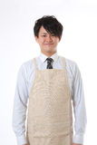 Apron and businessman. Businessman dressed in the apron Stock Images