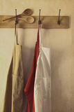 Aprons hanging on hooks with vintage feel Royalty Free Stock Images