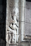 Apsara carving at Angkor Wat. Khmer sculptures of Apsara Dance with Mahabharata carvings on the wall of Angkor Wat Temple, Siem Reap, Cambodia Royalty Free Stock Image