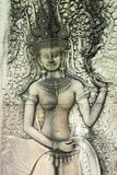 Apsara carving on wall of Angkor Wat Stock Photo