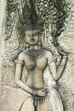 Apsara carving on wall of Angkor Wat Stock Photo