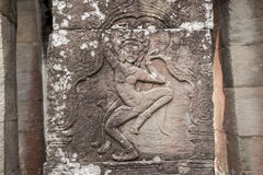 Apsara carvings status on the wall of Angkor temple, world herit Royalty Free Stock Photos