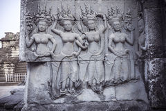 Apsara carvings status on the wall of Angkor temple, world herit. Age,  Siemreap, Cambodia Stock Photo