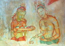 Apsara celestial nymphs - ancient painting. On the walls in the Lion Rock cave, 5th century, Sigiriya, Sri Lanka royalty free stock image