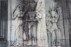 Apsara dancer. Carved into the walls of Angkor Wat, more than 1,000 dancer statues, none replicated, dot the walls of the famous temple in Cambodia stock photos